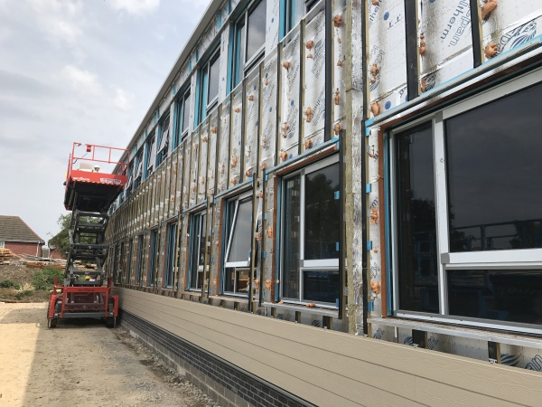 External wall cladding accelerates completion of Science Block